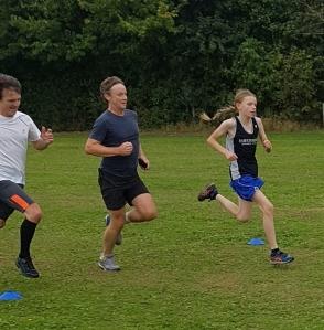 Three people in running race